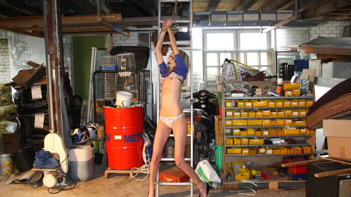 StrugglingBabes.com – Irena tied to ladder ballgagged.. Irena  Tit-grabbed